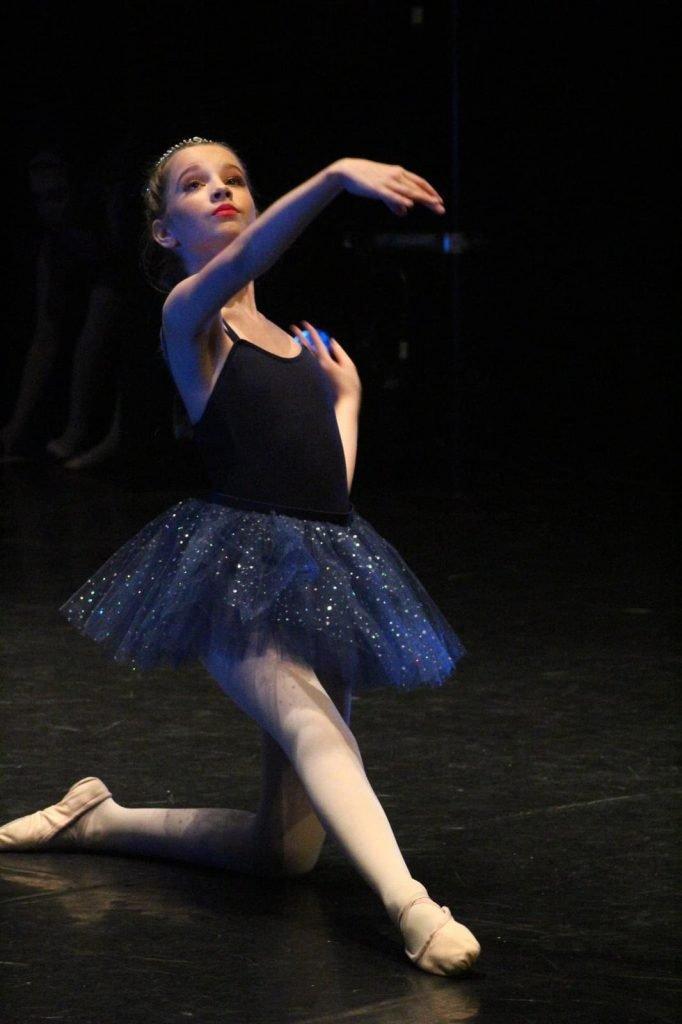 Girl posing in a ballet tutu