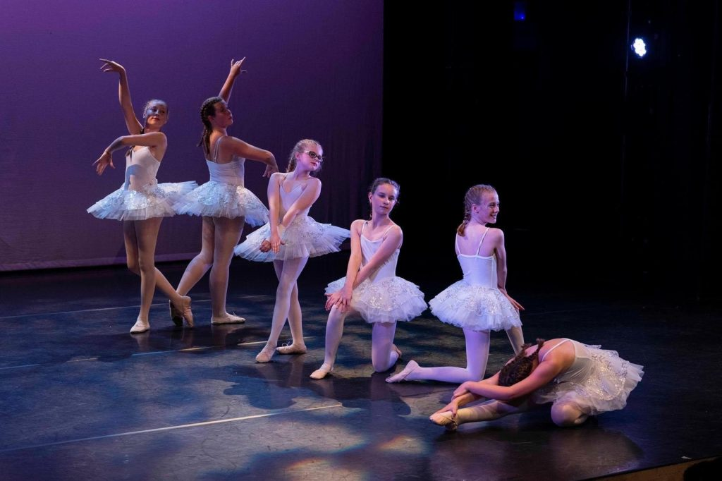 Girls in white tutus doing ballet