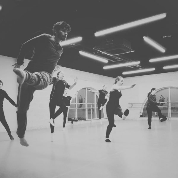 B&W image of people jumping