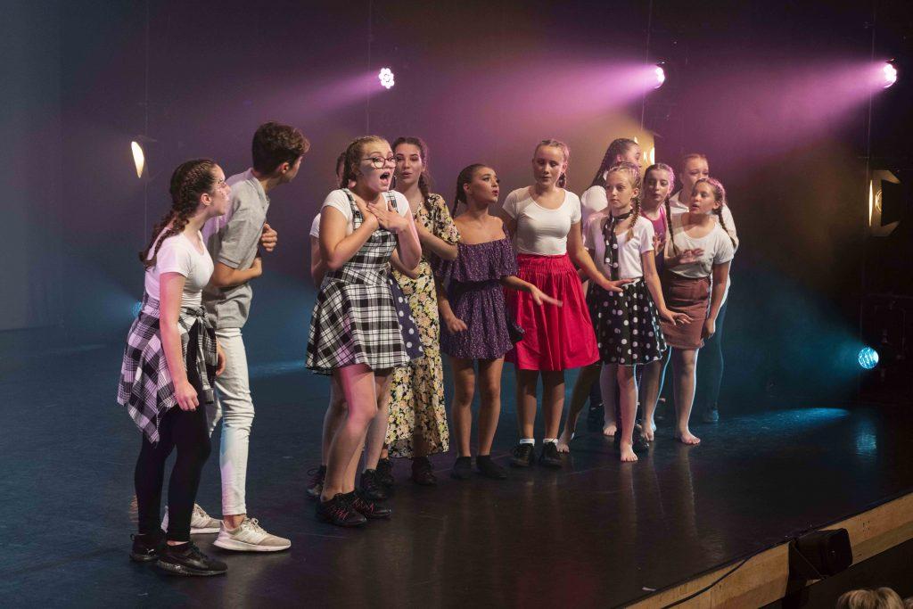 Kids singing on stage